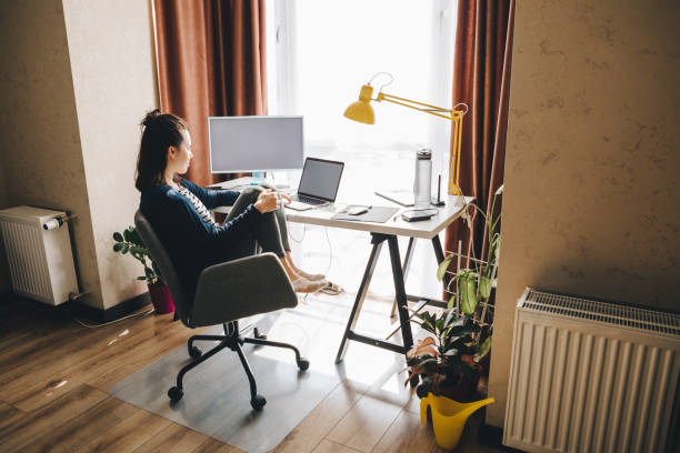 woman working at home. telework on laptop stock photo