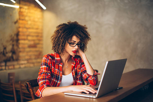 Woman working at laptop stock photo