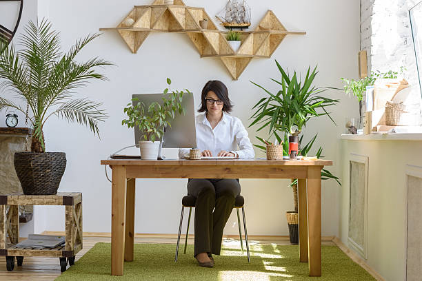 Woman working  at modern office stock photo