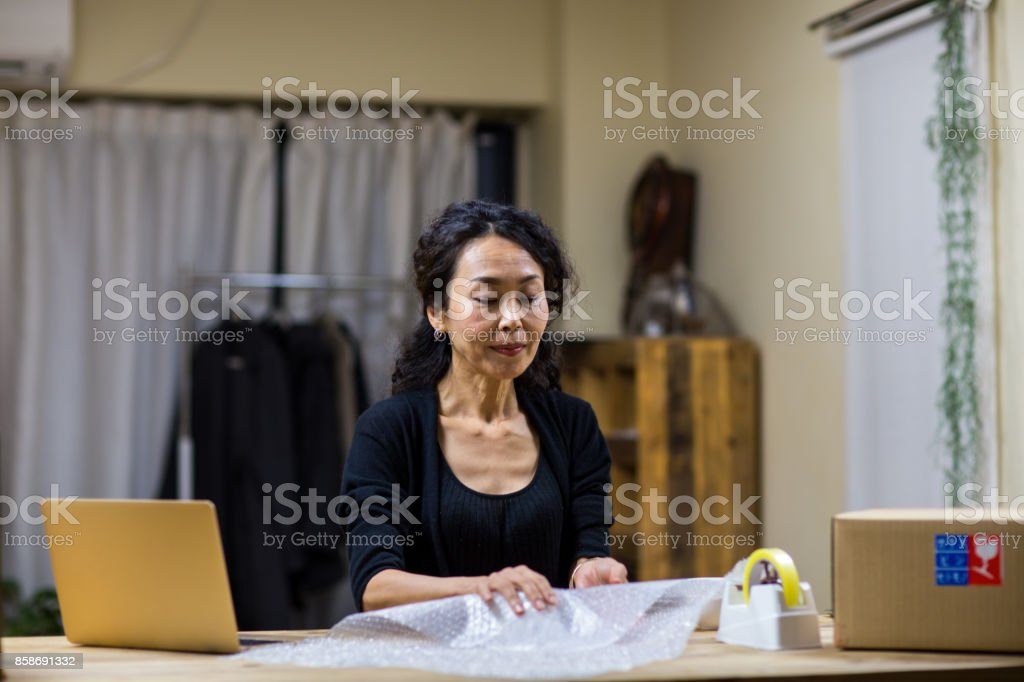 A woman working at shop stock photo