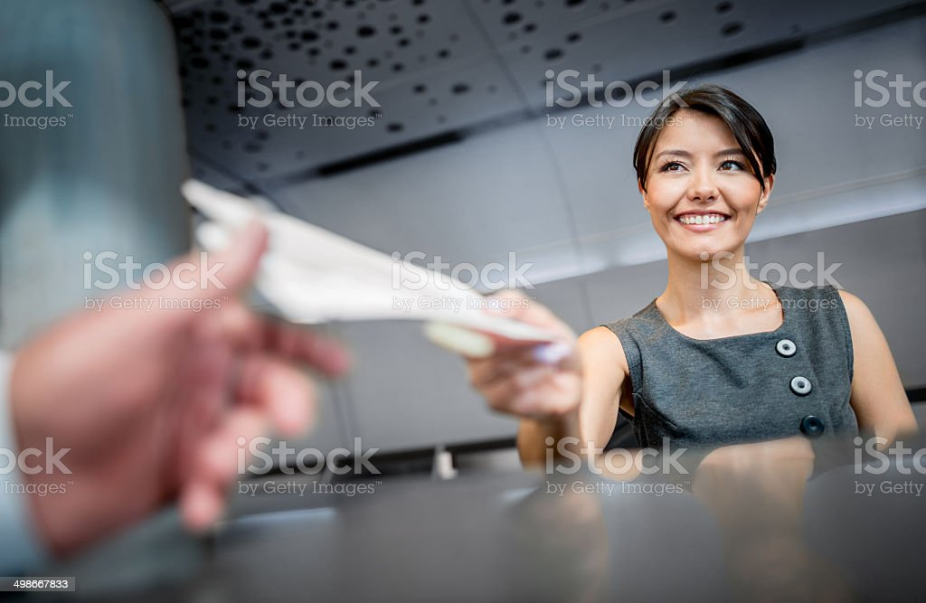 Woman working at the airport stock photo