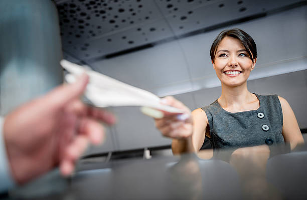woman working at the airport - airport check in counter stock pictures, royalty-free photos & images
