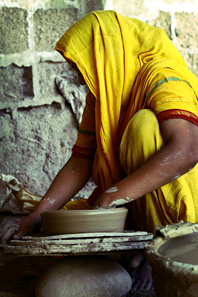 Woman working at the pottery wheel stock photo