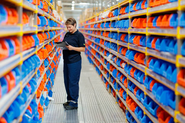 Woman working at warehouse stock photo