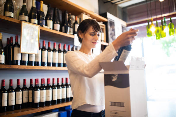 Woman working at wine store stock photo
