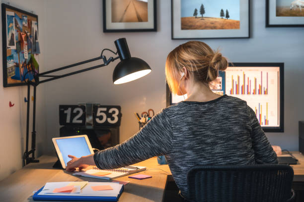 Woman Working From Her Home Office stock photo