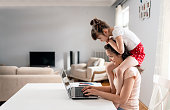 istock Woman working from home during quarantine with her little daughter all around 1227065156