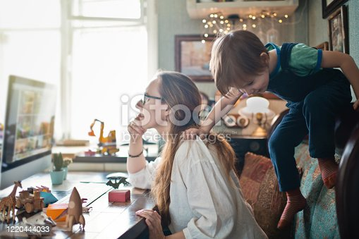 istock Woman working from home during quarantine with her little son all around 1220444033