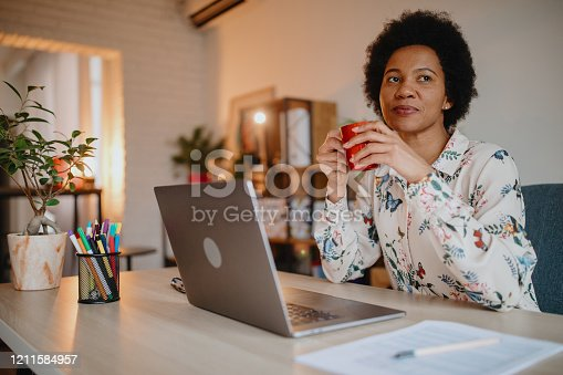 Hispanic woman working from home office. Latina woman working from home