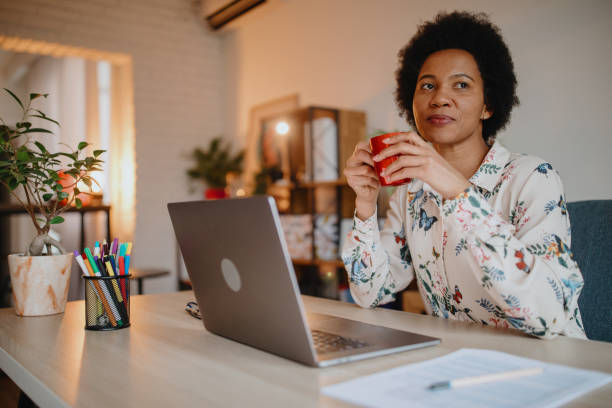 Woman working from home office stock photo