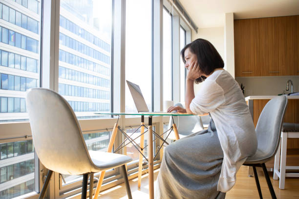 Woman working from Home stock photo