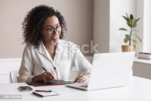 Freelancer woman working on laptop computer at home. Creative occupation, work from home, freelance, online learning, lockdown, studying concept. Distance education