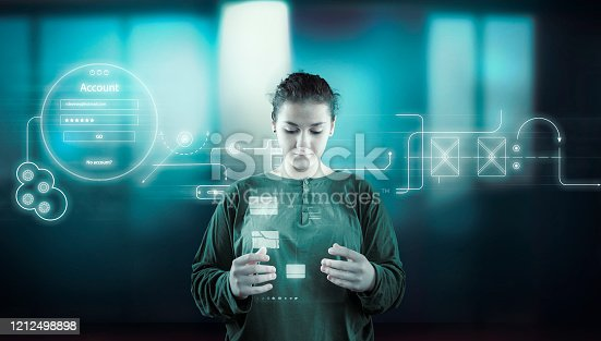 1054713428 istock photo Woman working futuristic user interface . High tech screens data and information . 1212498898