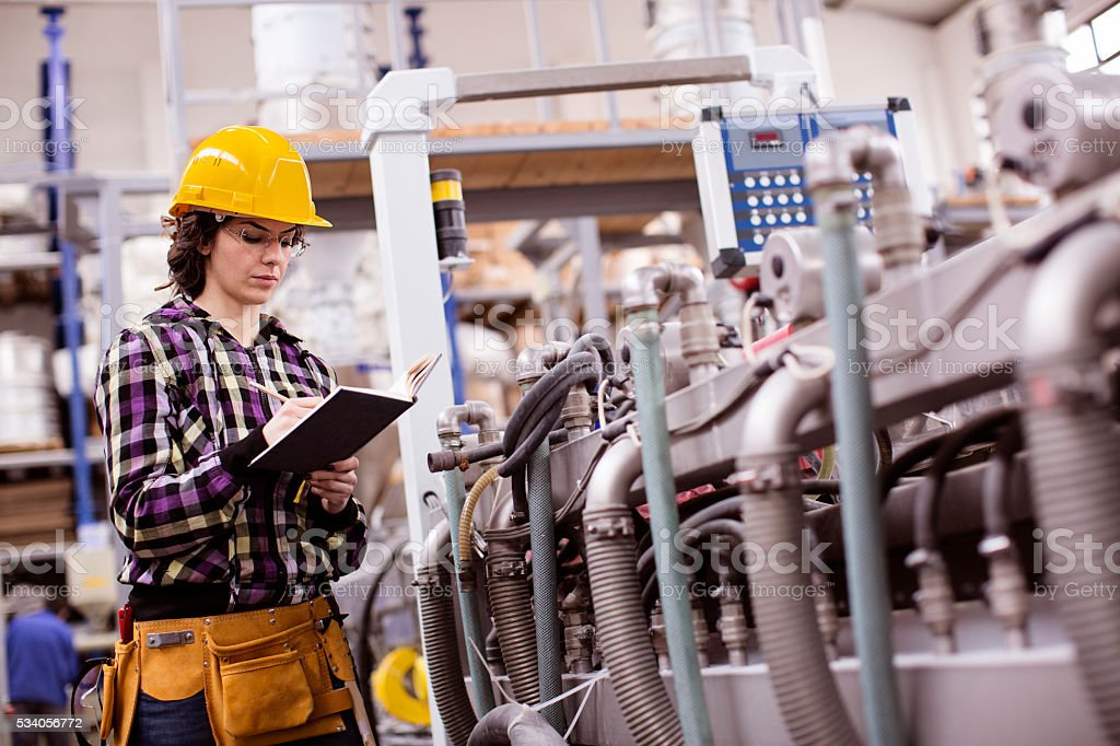 woman working in a factory stock photo