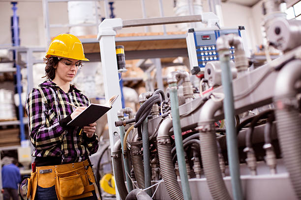 woman working in a factory Depth of field. Great processing photos.Used professional equipment. construction machinery stock pictures, royalty-free photos & images
