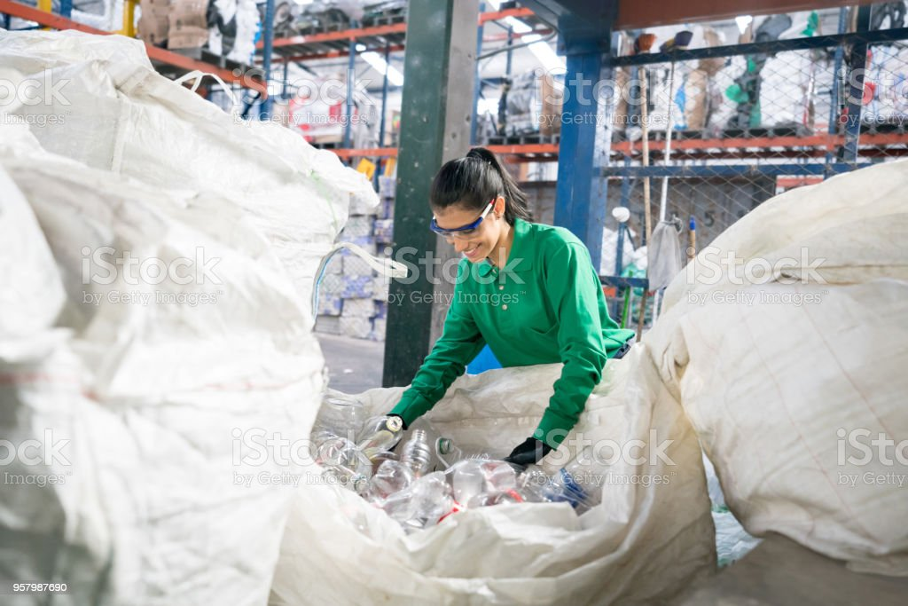 Woman working in a recycling factory stock photo