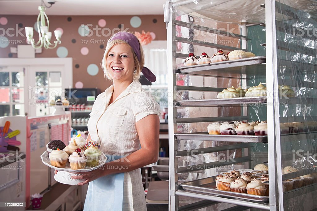 Woman working in bakery stock photo