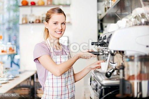 istock woman working in coffee shop 155278071