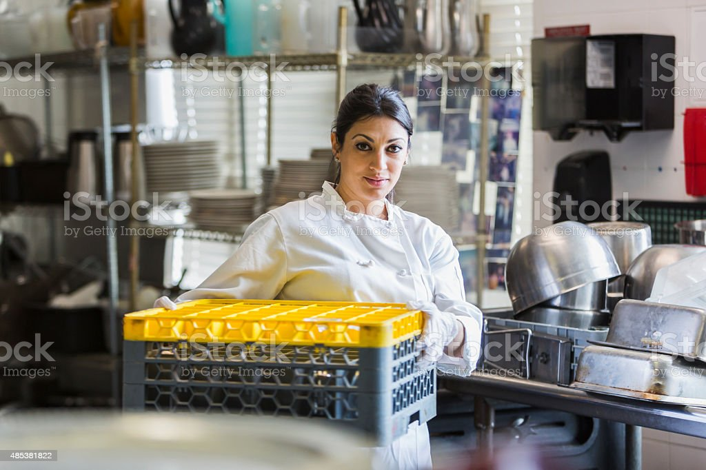 Woman working in commercial kitchen stock photo