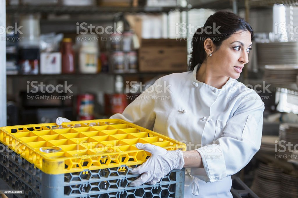 Woman Working In Commercial Kitchen Stock Photo - Download ...