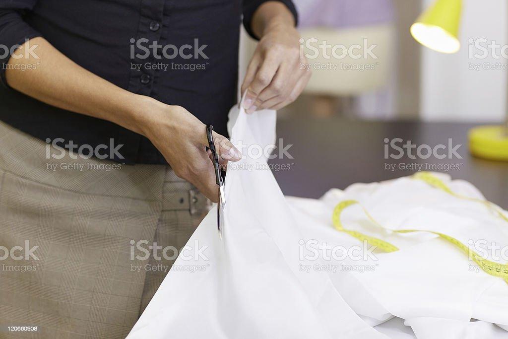 Woman working in fashion design studio royalty-free stock photo