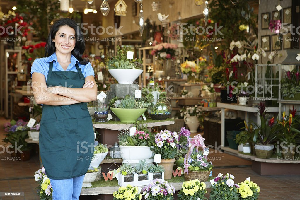 Woman working in florist Woman working in florist standing outside store 30-39 Years Stock Photo