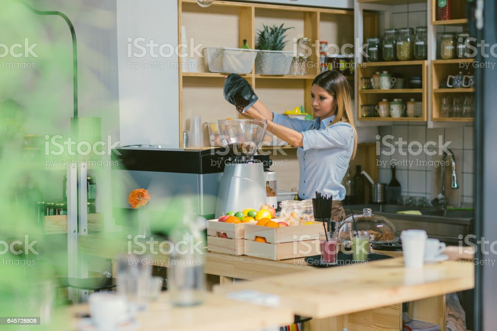 Woman Working In Her Cafe stock photo