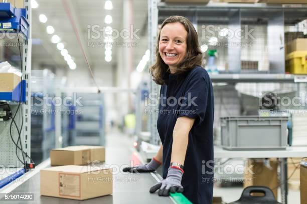 Woman working in large distribution warehouse picture id875014090?b=1&k=6&m=875014090&s=612x612&h= 5vib4ifs97wvm8mexvr9vauvxkawxy3frthsgd8i7i=