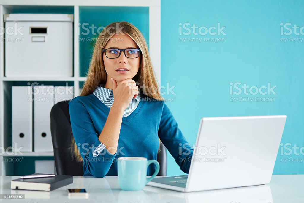 Woman working in office stock photo