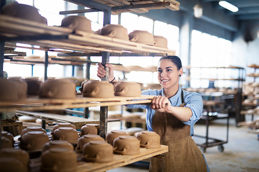 Woman working in pottery studio.