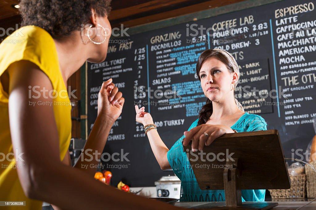 Woman working in restaurant taking customer order stock photo