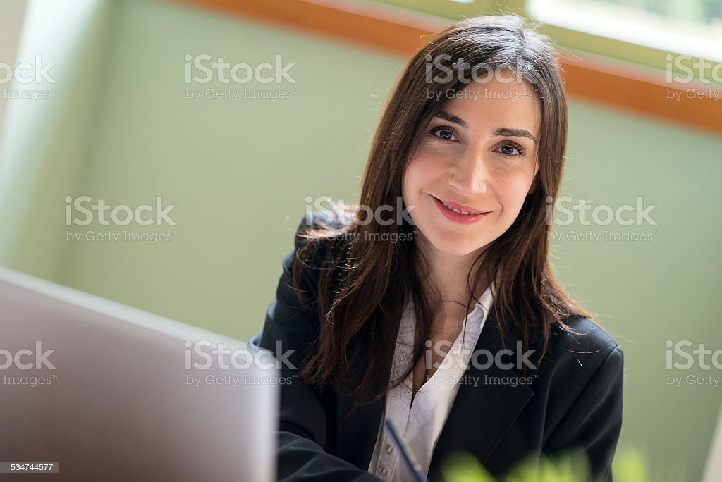 Woman working in startup coworking business office stock photo