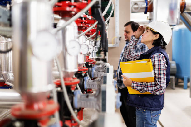 Woman working in the boiler room stock photo