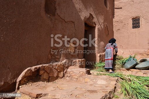 872393896istockphoto Woman working in the kasbah of Ait Ben Haddou 1175866934