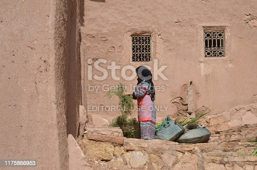872393896istockphoto Woman working in the kasbah of Ait Ben Haddou 1175866953
