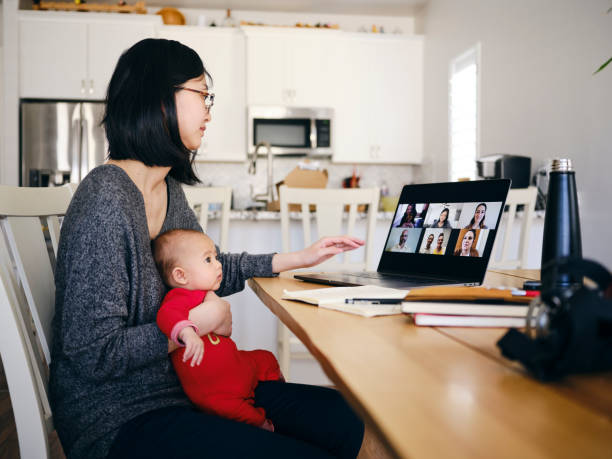 Woman Working Mother at Home on a Web Chat Meeting stock photo