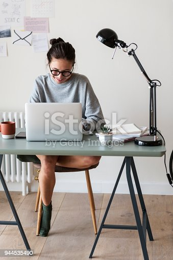 istock Woman working on a laptop in her home 944535490