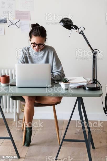 Woman working on a laptop in her home picture id944535490?b=1&k=6&m=944535490&s=612x612&h=b2da zu9wsenjwbccv5 frbelgzrpgic8d yuwu3cxo=