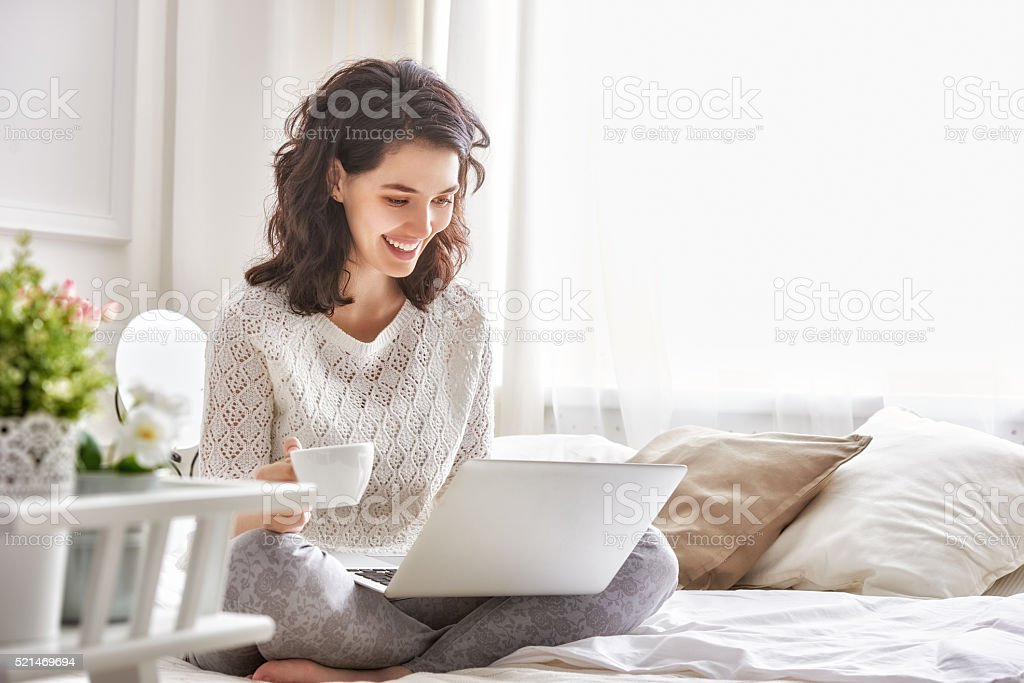 woman working on a laptop royalty-free stock photo