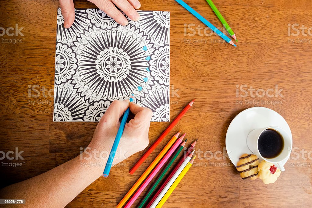 Woman Working On An Adult Coloring Book Design With Markers ...