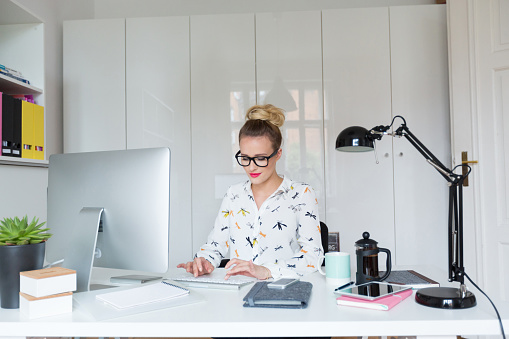 Woman Working On Computer In The Office Stock Photo - Download Image Now