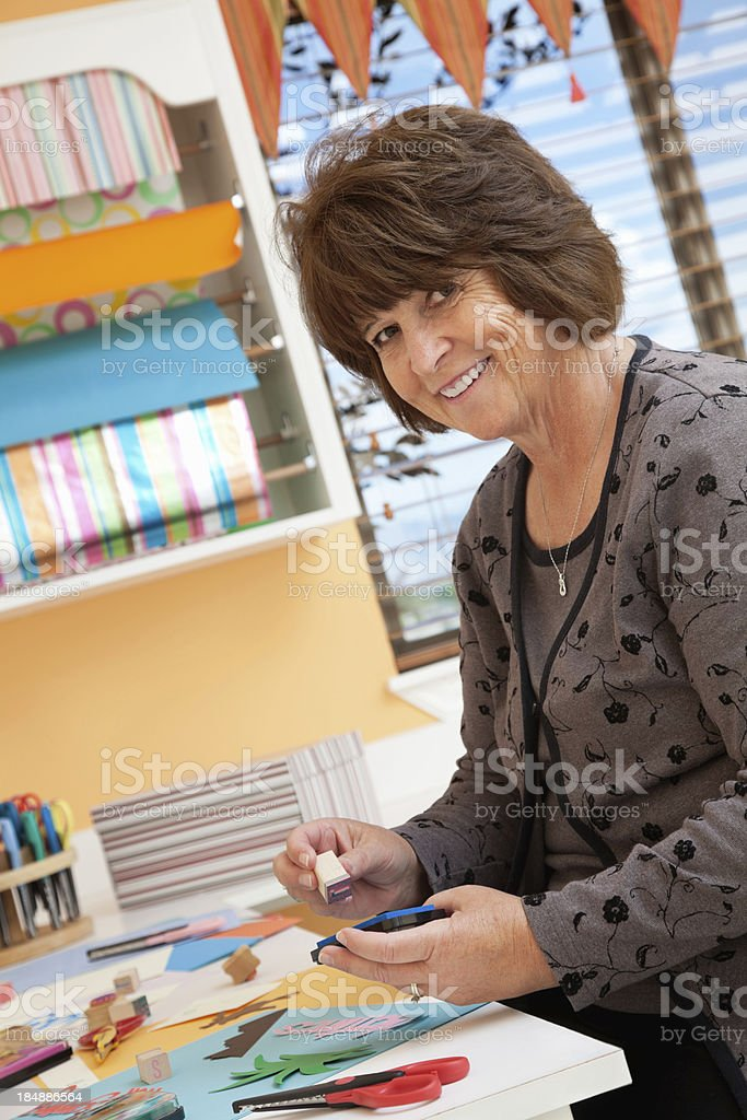Woman working on crafts in her home craft room royalty-free stock photo