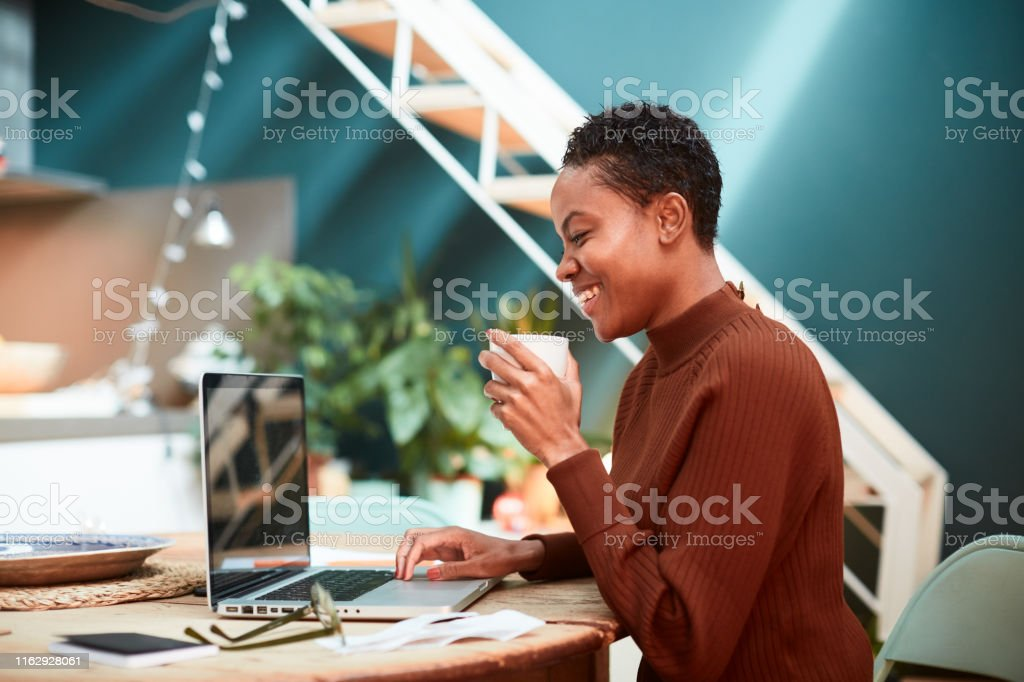 Woman working on her finances at home, filling up tax forms. Lifestyle home concepts made in Barcelona. Accountancy Stock Photo