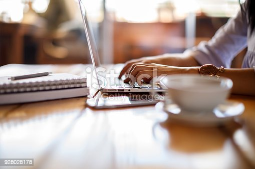 istock Woman working on laptop at a cafe 928028178