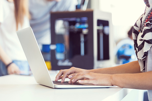 Woman Working On Laptop In 3d Printer Office Stock Photo - Download Image Now