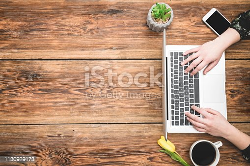 Woman working on laptop with