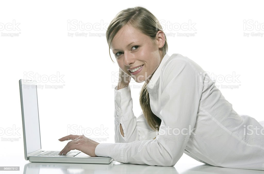 Woman working on laptop royalty-free stock photo
