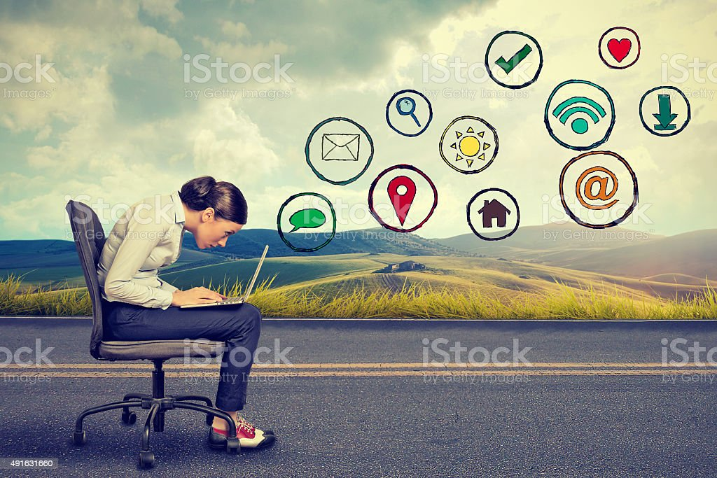 woman working on laptop using social media application stock photo