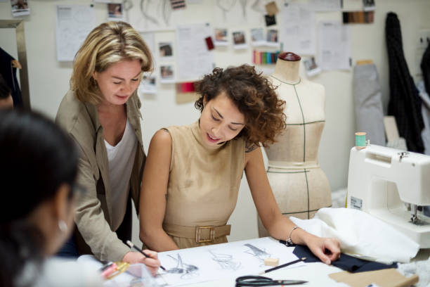 Woman working on projects Woman working on projects fashion designer stock pictures, royalty-free photos & images
