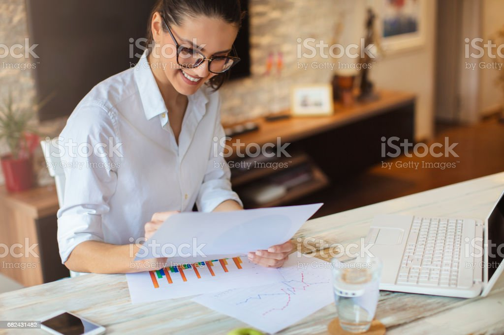 Woman working on the new project royalty-free stock photo